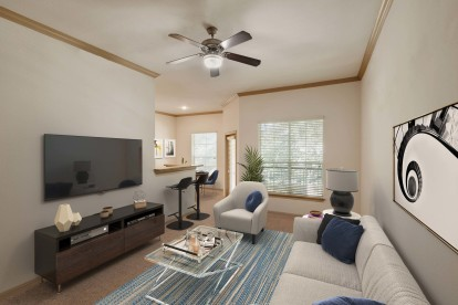 Spacious living room space with bar steading and private patio