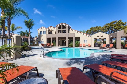 Pool with sundeck and outdoor dining areas