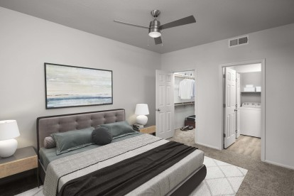 Bedroom with lighted ceiling fan, ensuite bathroom, and walk-in closet
