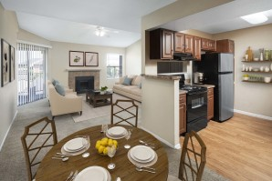 Kitchen dining and living room with sliding glass doors to private balcony