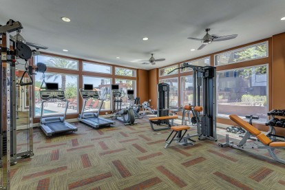 24 hour fitness center with cardio and strength training equipment