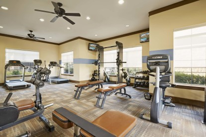 24-hour fitness center with strength and cardio equipment