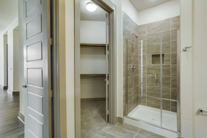 Bathroom with glass enclosed tiled shower