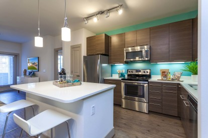 Kitchen with island and stainless steel appliances