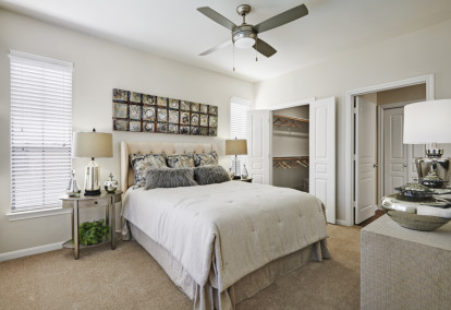 Contemporary-style bedroom with walk-in closet at Camden Farmers Market Apartments in Dallas, TX