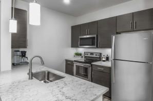 Modern garden apartment kitchen with stainless steel appliances