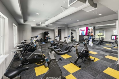Spin class cycle room fitness with on demand trainer