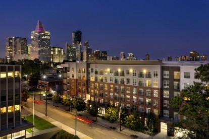 Exterior twilight with city skline views