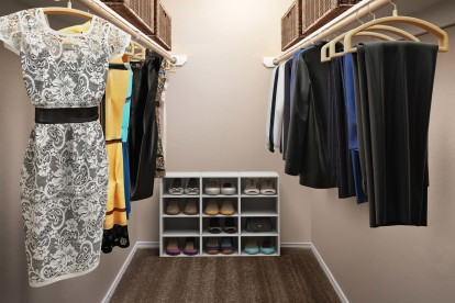 Large closet with built in hanging racks