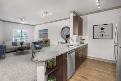 Kitchen with granite countertops, hardwood-style flooring, and track lighting
