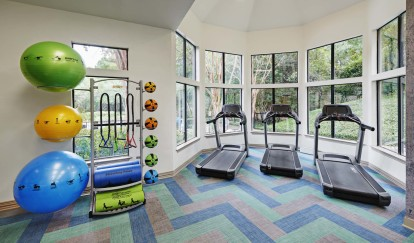 24 hour fitness center with cardio and yoga equipment