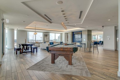 resident clubroom with pool table and ample seating