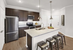 Kitchen with white granite counters and wood style floors