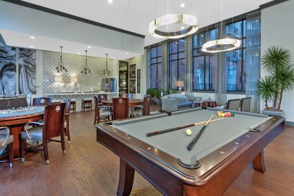 Resident lounge billiard and seating at Camden Gallery Apartments in Charlotte, NC