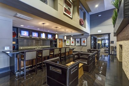 Resident lounge with kitchenette and dining and barstool seating