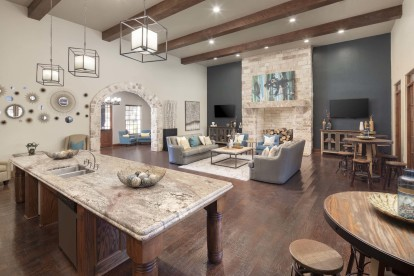 Second clubhouse with televisions and entertaining kitchen