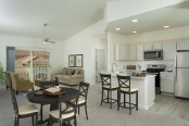 Open concept kitchen with vaulted ceiling balcony