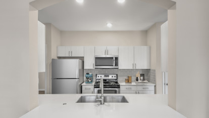 Kitchen with quartz countertops at Camden Governors Village Apartments in Chapel Hill, NC