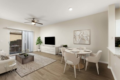 Open concept dining and living room with ceiling fan wood style flooring and patio
