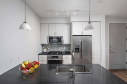 Kitchen with granite countertops stainless steel appliances and gas cooktop