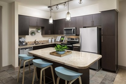 Contemporary style kitchen with granite countertops and stainless steel appliances
