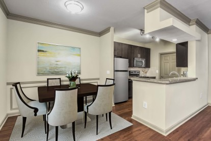 Dining room and kitchen with wood look flooring