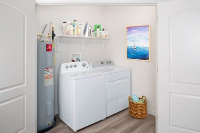 Full-size Whirlpool washer and dryer.