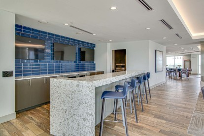 Resident clubroom with entertaining kitchen and bartop