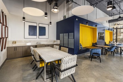 The hub community workspace with dining table and seating options for work stations