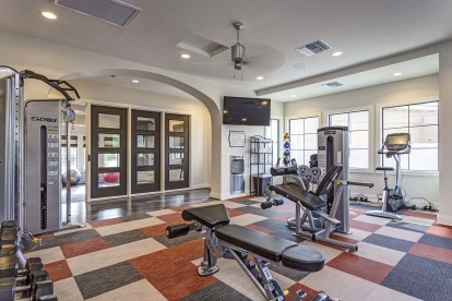 Fitness center with weight machines and dumbbells and stationary bikes