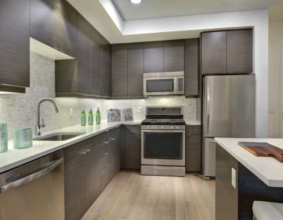 Open concept kitchen with bottom freezer refrigerator and gas range
