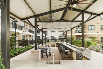 Barbeque grills and covered outdoor dining area