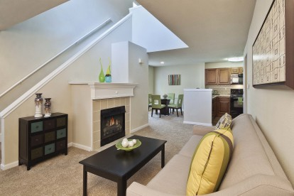 Traditional style open concept living dining kitchen with fireplace and loft