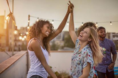 Friends enjoying a rooftop gathering