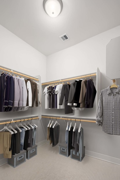 Walk in closet with wood shelving