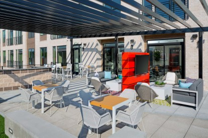 Resident Lounge with Outdoor TV and dining areas