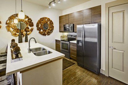Kitchen with white quartz countertops and stainless steel appliances