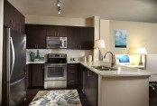 Open concept kitchen with energy efficient stainless steel appliances