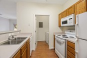 Kitchen laundry room with full size washer and dryer