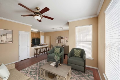 Spacious living room with hardwood-style floors and 9-foot ceilings