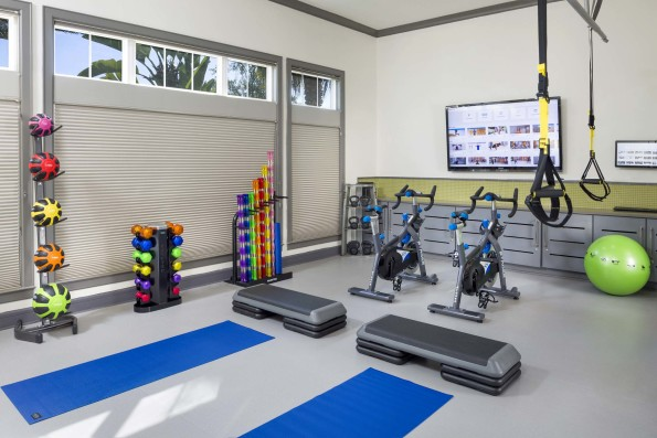 Yoga studio with spin bikes and on-demand training