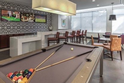 24 hr resident game lounge with pool billiards table flat screen tvs and entertaining kitchen