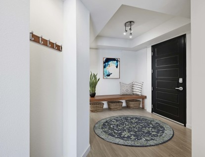 Entryway to home with mudroom area