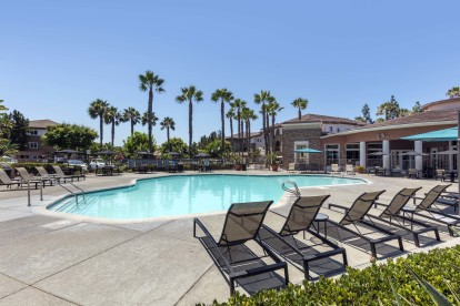 Swimming pool chairs on sundeck