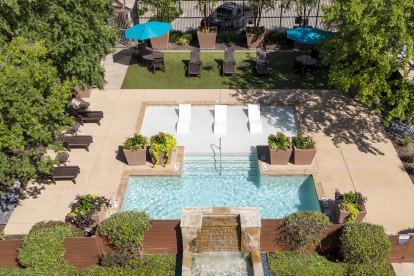 Pool with sundeck and water feature