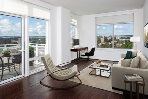 Open living room with large windows balcony with incredible city views and home office space