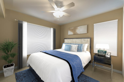 Bedroom with ceiling fan and lots of natural light