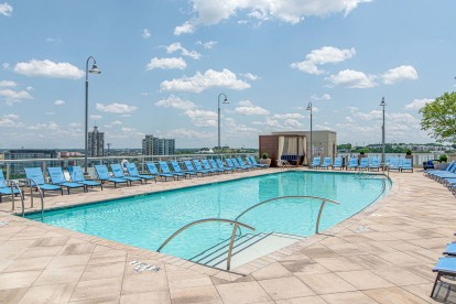 Rooftop pool with lounge seating