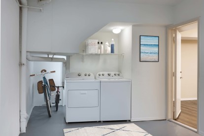 Large garage with full size washer dryer and room for storage