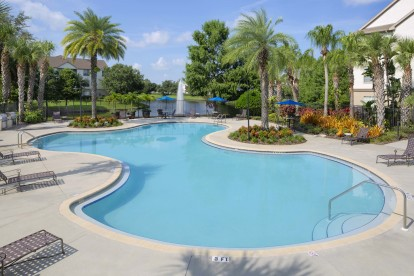 Swimming pool with sundeck, hot tub, and grilling stations